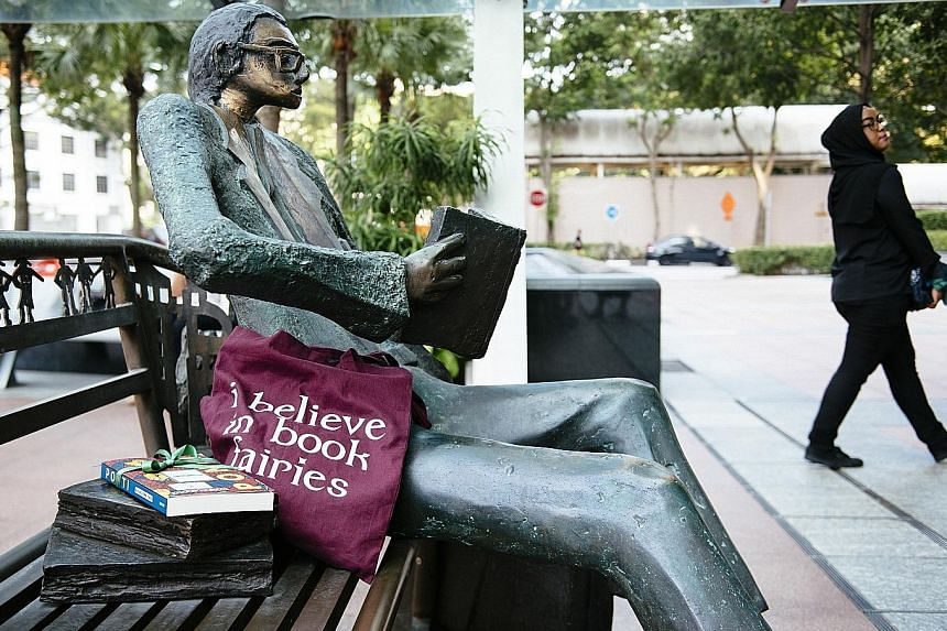 Housewife Petra Sander from Book Fairies Singapore and author Sharlene Teo recently left books around Singapore for members of the public to discover, including beside the sculpture Man On The Bench (above) in front of Capitol Tower.