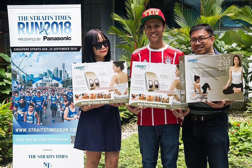 From left: Winners of the ST Run Mother's Day Giveaway Lee Poh Lin, Irfan Noor and Yeo Buck Huat with their back-massager prizes.