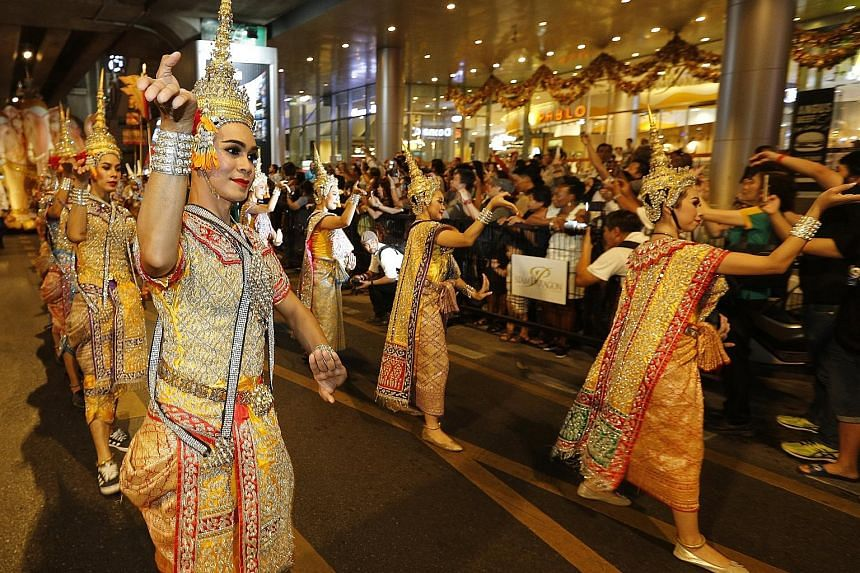 Thai dancers performing during the opening ceremony of the Amazing Thailand Tourism Year 2018 parade in Bangkok last November. In the January-March quarter, tourist numbers surged 15.4 per cent, private consumption was up 3.6 per cent, and private in