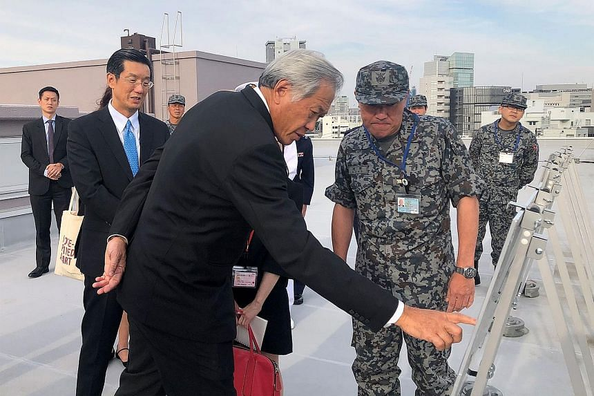 Visiting Defence Minister Ng Eng Hen receiving a briefing on the Patriot Advanced Capability-3 interceptor systems at Japan's Ministry of Defence yesterday. The land-based PAC-3 surface-to-air missile interceptor can destroy targets at altitudes of u