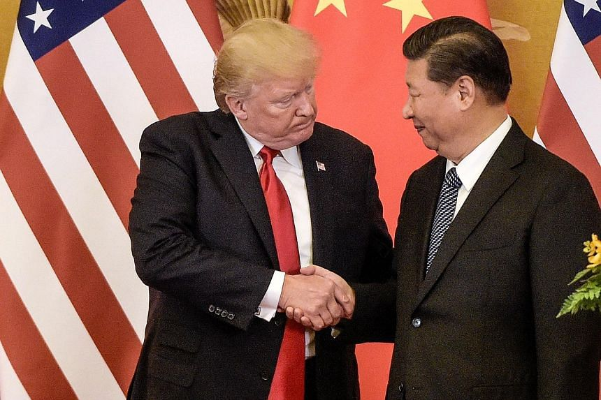 US President Donald Trump and Chinese President Xi Jinping during a meeting on Nov 9 last year in Beijing. US administration officials have tried to cast the latest trade talks as a victory, but some supporters of Mr Trump questioned if he had blinke