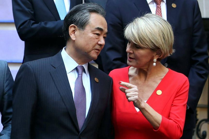 Australia's Foreign Minister Julie Bishop (right) talks to her China counterpart Wang Yi at the G-20 Foreign Ministers' Meeting in Buenos Aires, on May 21, 2018.