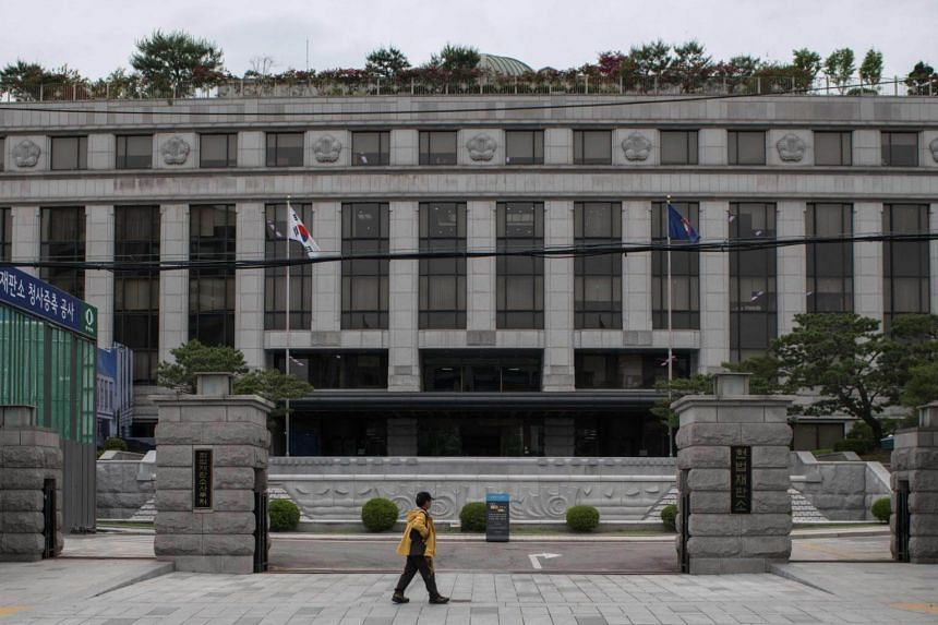 A man walking past the Constitutional Court in Seoul. The court is due to review a challenge from a doctor who was prosecuted for performing nearly 70 abortions.