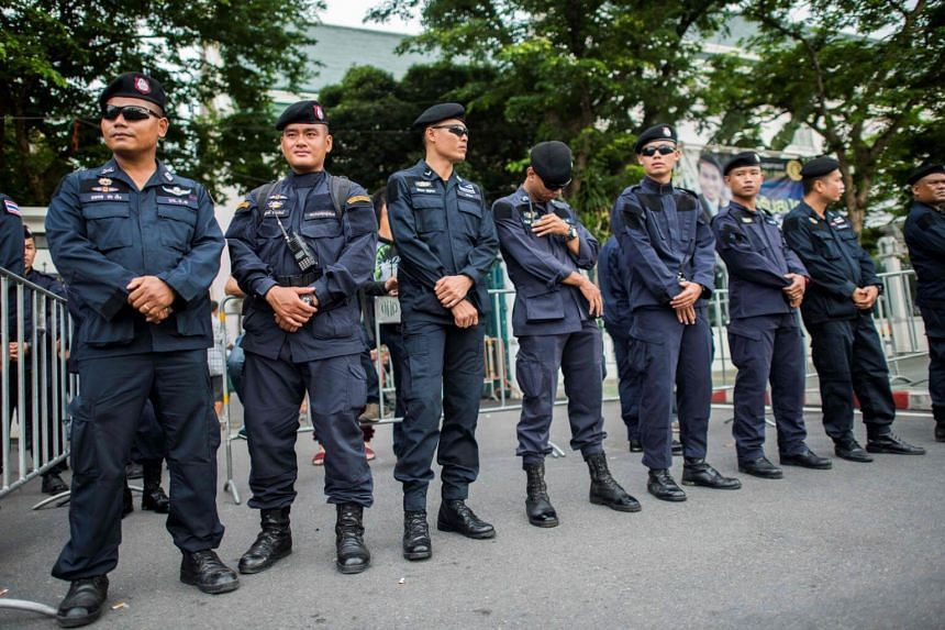 Royal Thai police secure an entrance of the Thammasat University as protesters gather for a demonstration to mark the fourth year of junta rule in Bangkok on May 22, 2018.
