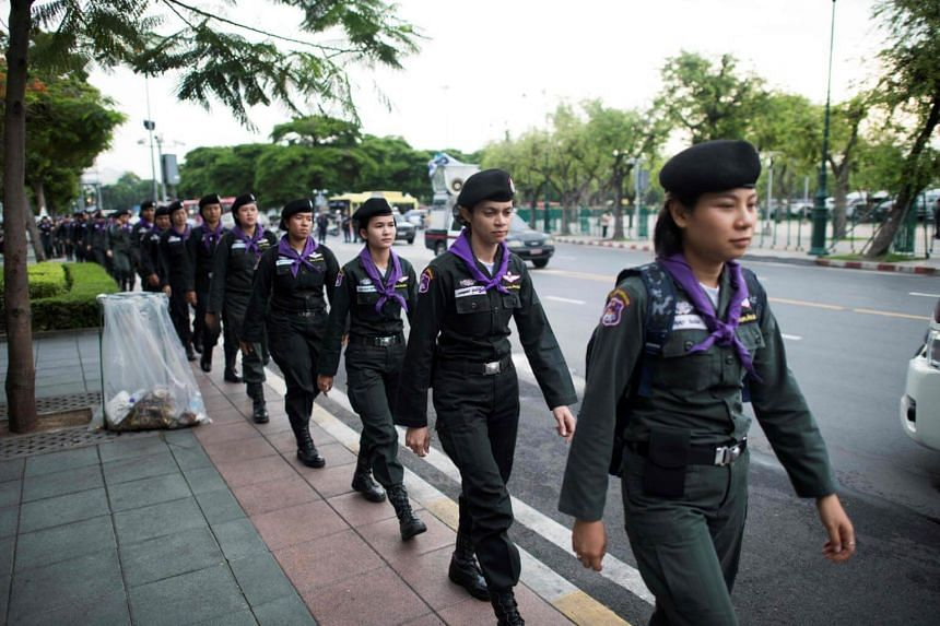 Royal Thai police arrive to secure a road near the Thammasat University as protesters gather for a demonstration to mark the fourth year of junta rule in Bangkok on May 22, 2018.