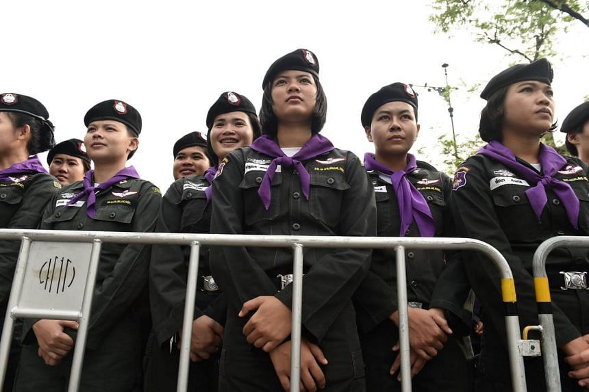 A phalanx of Thai police women stand behind a police barricade outside Thammasat University during a protest in Bangkok, on May 22, 2018.