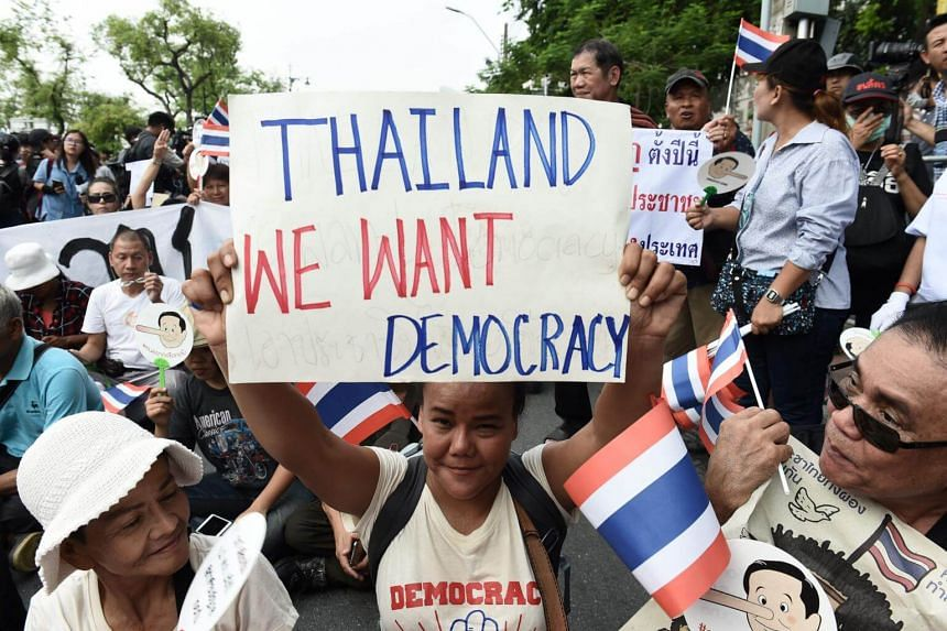 Demonstrators gather near a police barricade outside Thammasat University during a protest in Bangkok, on May 22, 2018.