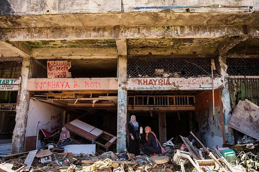 Very few structures were left standing after the army rained artillery shells and bombs to flush out the militants. Those still standing are nothing more than empty hulls – just four corners of a house.
