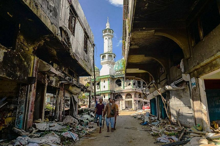 The minaret of Marawi's largest mosque, in an area that was once a thriving commercial hub. Officials say the mosque will have to be demolished and rebuilt from scratch. When The Straits Times visited the area two weeks ago, the smell of war – a