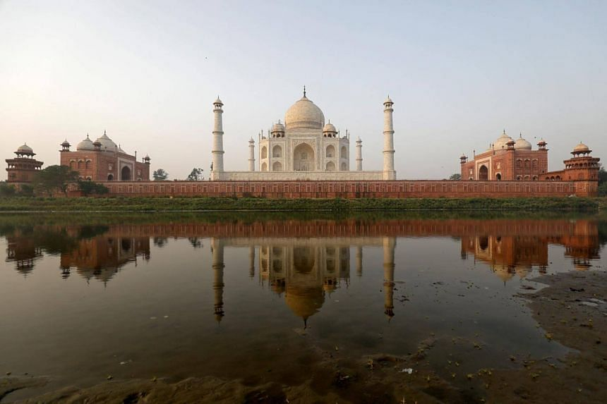 The Taj Mahal flanks a garbage-strewn river and is often enveloped by dust and smog from belching smokestacks and vehicles in the northern city of Agra.