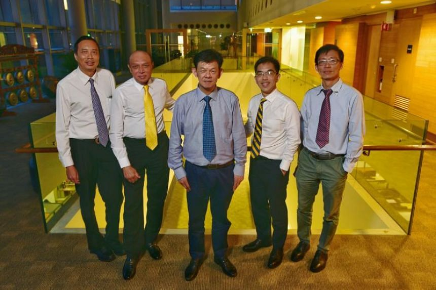 (From left) President of Singapore National Academy of Science Andrew Wee,  Professor of Obstetrics & Gynecology, Yong Loo Lin School of Medicine, National University of Singapore, Ariff Bongso, Professor of Chemistry, Nanyang Technological Universit