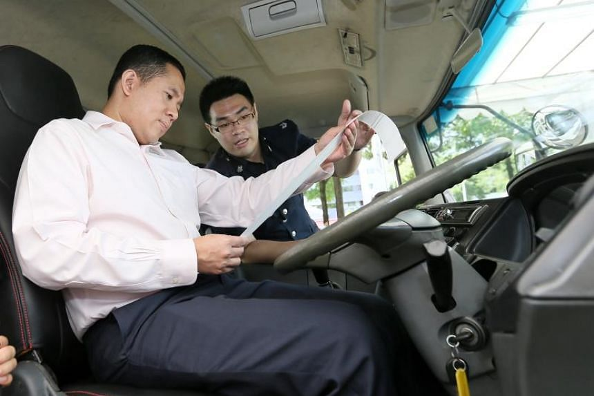 Senior Parliamentary Secretary for Health and Home Affairs Amrin Amin viewing a container truck equipped with speed-tracking devices.
