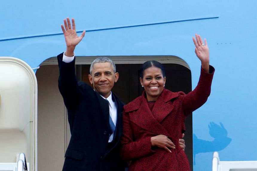 Former President Barack Obama waves with his wife Michelle as they board Special Air Mission 28000, a Boeing 747 which serves as Air Force One, at Joint Base Andrews, Maryland, US on Jan 20, 2017.