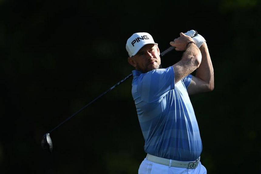 England's Lee Westwood hits his tee shot on the second hole during the third round of the Houston Open on March 31, 2018.