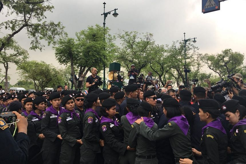 Female battalion forming up a police barricade outside Thammasat University during a protest to mark the fourth year of junta rule in Bangkok, on May 22, 2018.