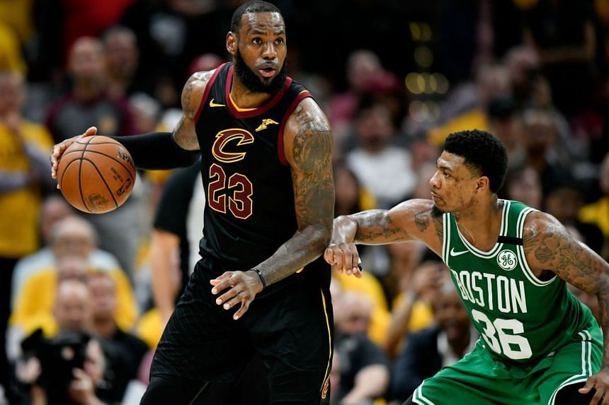Cleveland Cavaliers forward LeBron James (left) drives to the basket against Boston Celtics guard Marcus Smart during the forth quarter in game four of the Eastern conference finals of the 2018 NBA Playoffs.