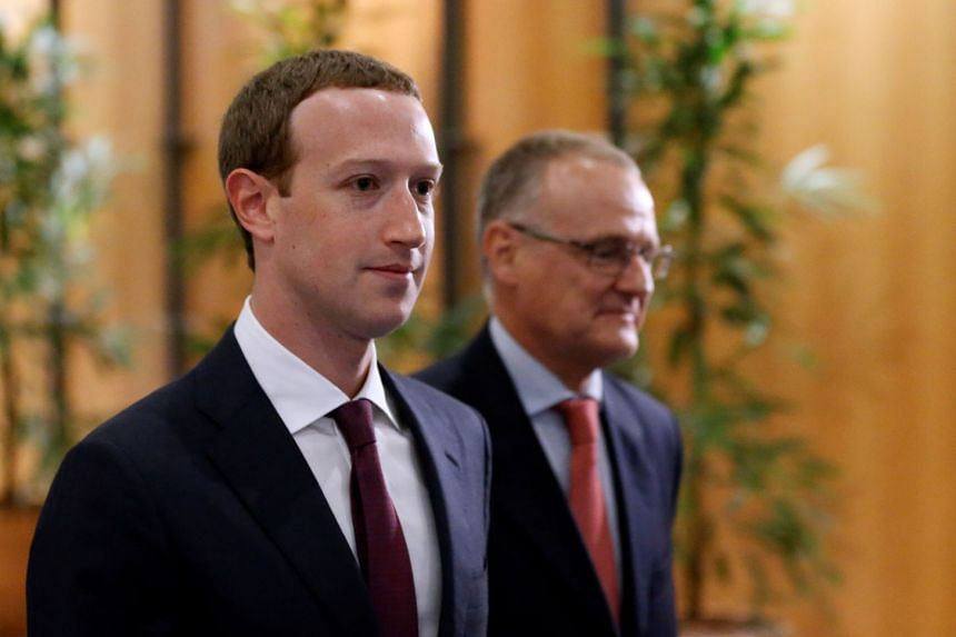 Zuckerberg arrives at the European Parliament to answer questions.