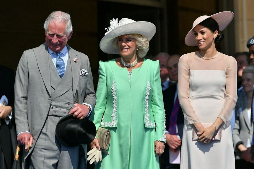 Meghan attends a garden party at Buckingham Palace with Camilla, Duchess of Cornwall, and Prince Charles.