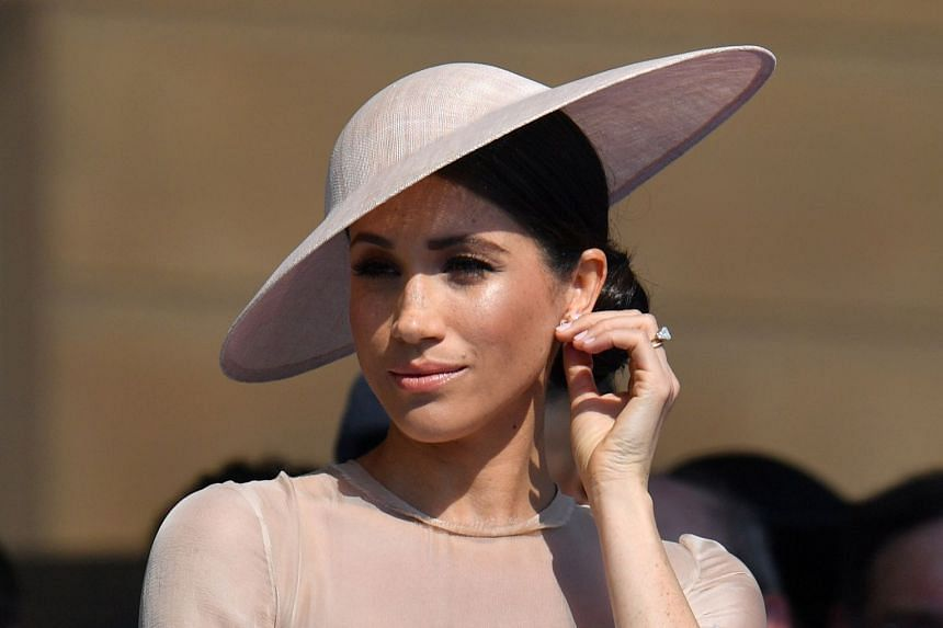 Meghan, Duchess of Sussex attends a garden party at Buckingham Palace.