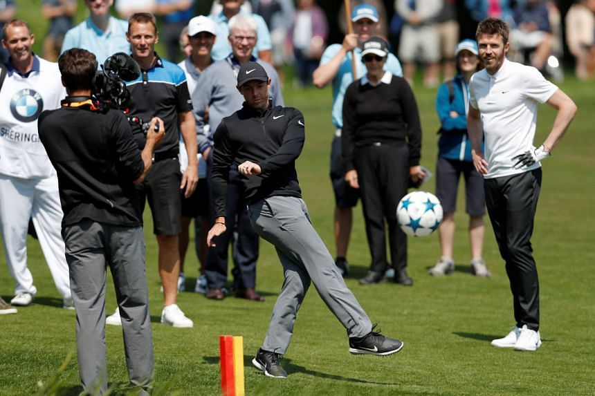 McIlroy plays footgolf during the pro-am.