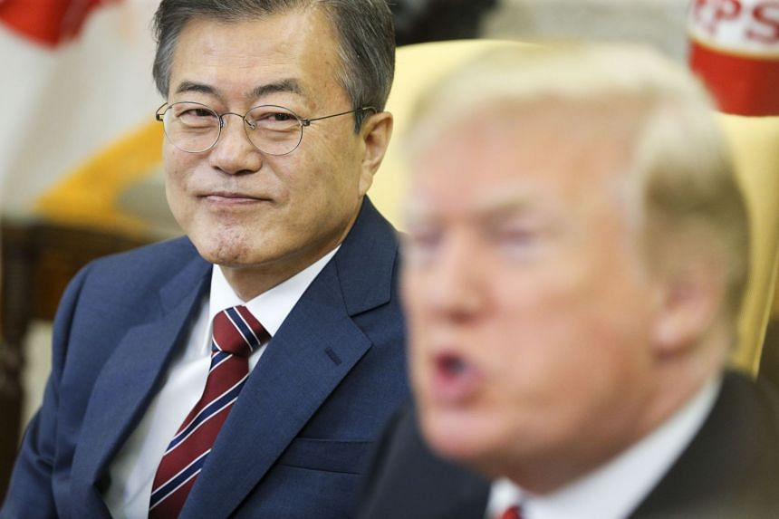 Moon Jae In listens as Donald Trump speaks during a meeting at the White House, May 22, 2018.