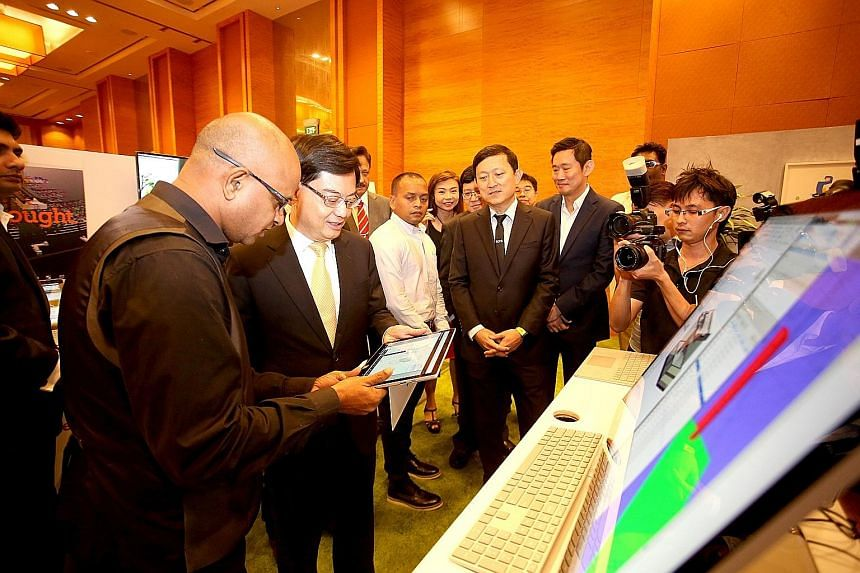 Finance Minister Heng Swee Keat visiting the Microsoft Singapore booth at the annual conference jointly held by the Board of Architects and the Association of Consulting Engineers Singapore yesterday.