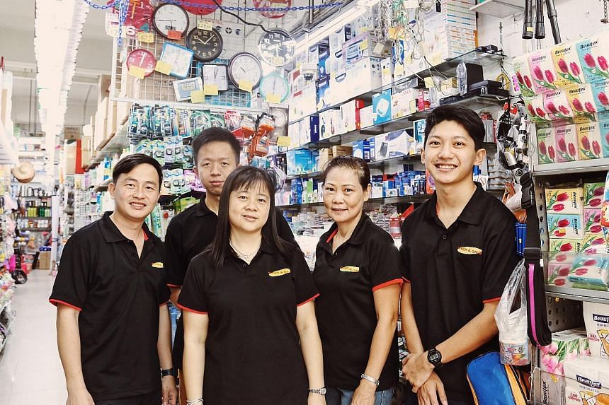 From left: Mr Lee Wei Ping, 36; Mr See Lai Huat, 29; Ms Lee Poh Luan, 47; Ms Chiang Yeok Wah, 59, and Mr Alex Chua, 21, work at Offer and Save Superstore. Mr Lee, the store supervisor, has worked at the store since it opened in 2006.