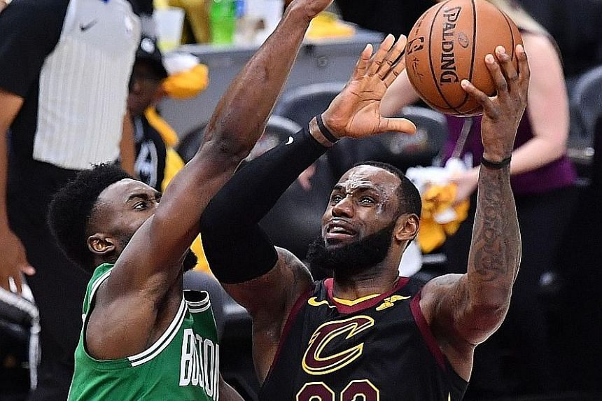 Cleveland's LeBron James driving to the basket in the third quarter of Monday's Game Four against Boston's Jaylen Brown.