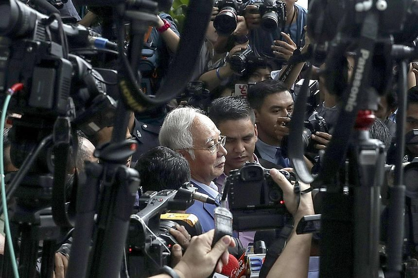 Former Malaysian prime minister Najib Razak leaving the Malaysian Anti-Corruption Commission headquarters in Putrajaya yesterday. He was questioned for five hours over transactions involving state firm SRC International, which was once a subsidiary o