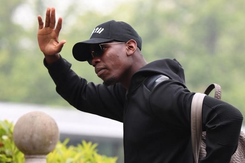 French midfielder Paul Pogba arriving at the French team's training camp in Clairefontaine-en-Yvelines, outside of Paris, ahead of the 2018 World Cup, on May 23, 2018.
