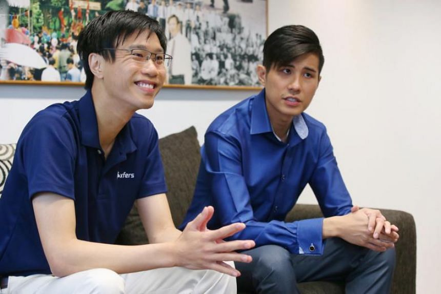 Xfers co-founder Samson Leo (left) with Singapore Police Force senior investigation officer of the Technology Crime Division, Mr Edwin Choo. Xfers, like PayPal, works by having users top up their e-wallet to trade online.