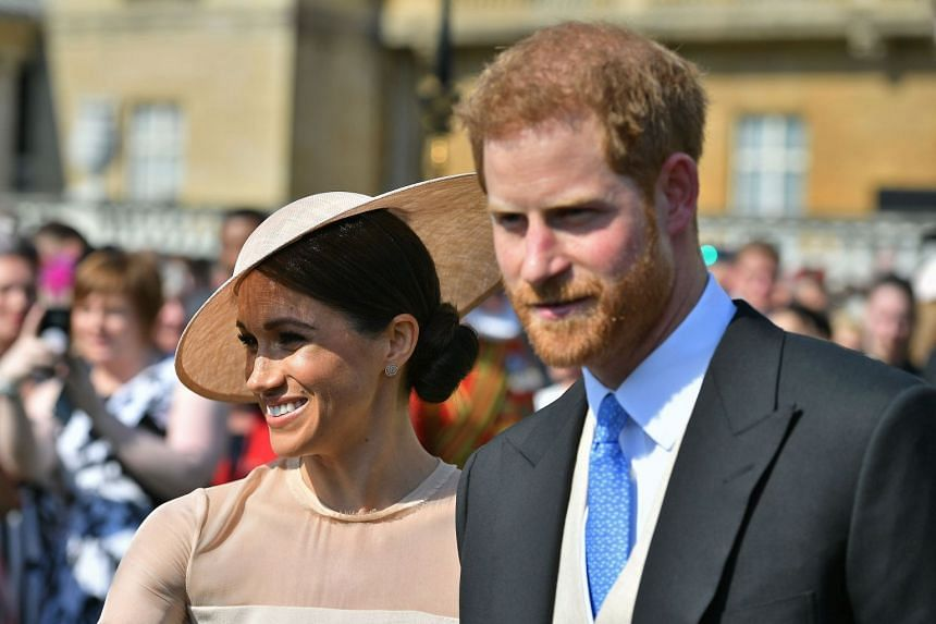 Harry and Meghan attend the Prince of Wales' 70th Birthday Garden Party at Buckingham Palace.