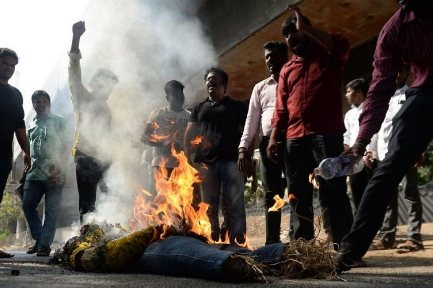 Indian protesters burn an effigy of Vedanta Resources executive chairman Anil Agarwal during a protest in Chennai, on May 22, 2018.