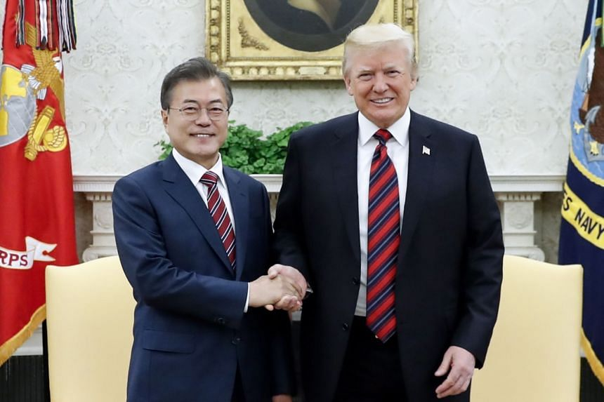 South Korean President Moon Jae In and US President Donald Trump shake hands during a meeting at the White House in Washington, DC, on May 22 2018.