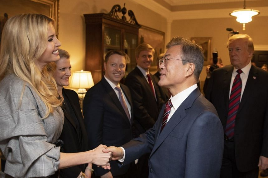 South Korean President Moon Jae In shaking hands with White House adviser Ivanka Trump at the White House in Washington, DC, on May 22, 2018.