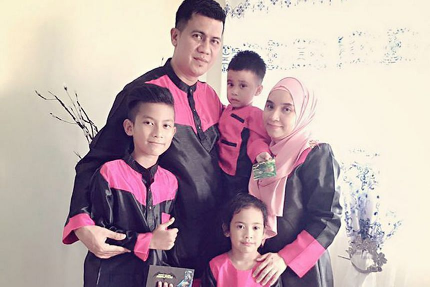 The late Nur Alam Shah with his family (from left) son Haziq Shah, 14; four-year-old Muhammad Royyan; wife Azean Aziz; and eight-year-old daughter Auni Syahindah.