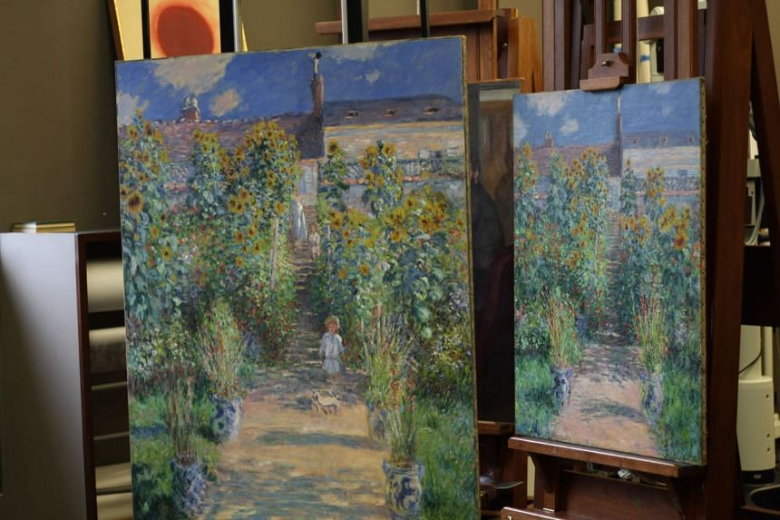 Claude Monet's two paintings of The Artist's Garden At Vetheuil are seen unframed at the National Gallery of Art's conservation laboratory in Washington.
