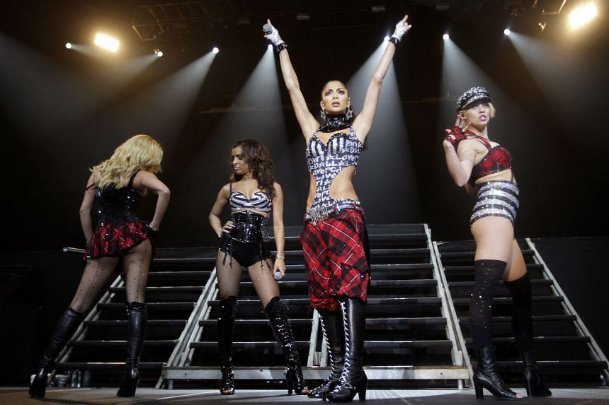 The Pussycat Dolls, led by Nicole Scherzinger (second from far right), in a gig in Singapore in 2009.