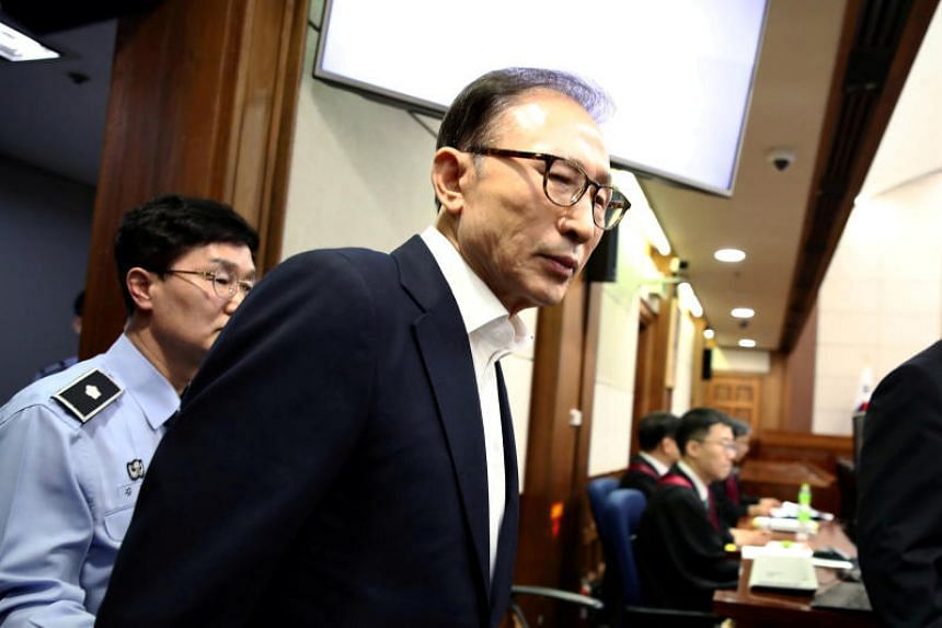 Former South Korean President Lee Myung Bak appears for his first trial at the Seoul Central District Court in Seoul, South Korea, on May 23, 2018.