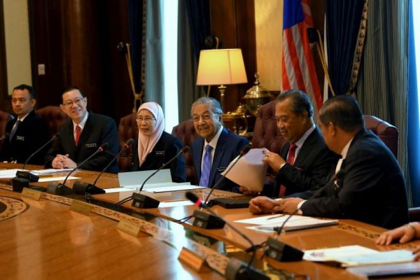 Dr Mahathir (third from right) chairing his first Cabinet meeting at Perdana Putra, on May 23. Also present were (from left) Education Minister Maszlee Malik, Finance Minister Lim Guan Eng, Deputy Prime Minister Wan Azizah Wan Ismail, Home Minister M
