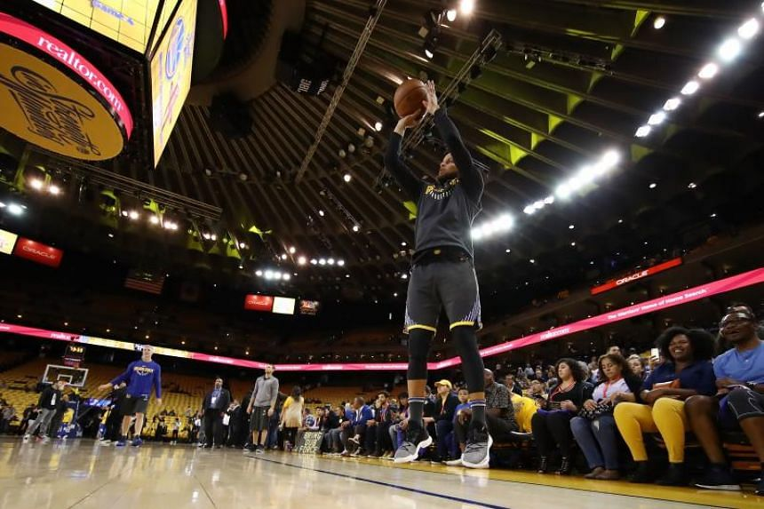Stephen Curry of the Golden State Warriors warms up prior to Game Four of the Western Conference Finals of the 2018 NBA Playoffs against the Houston Rockets, on May 22, 2018.