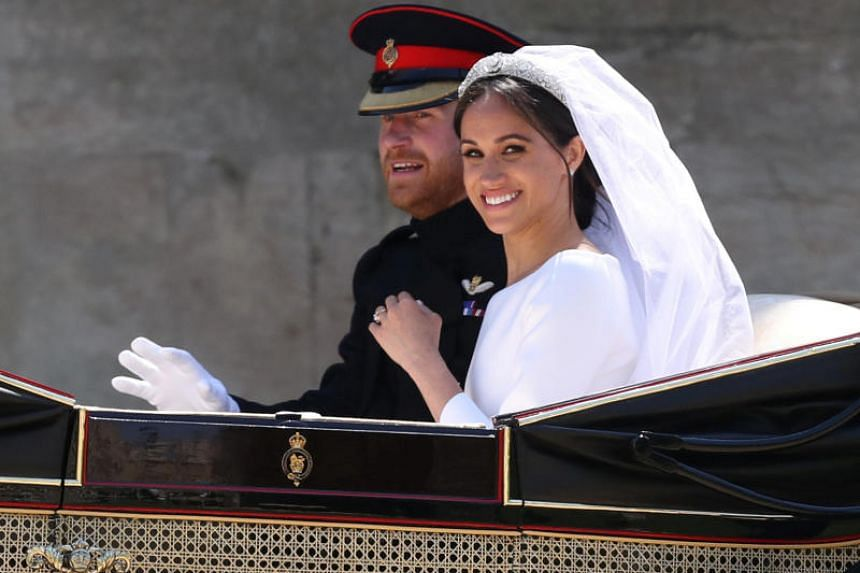 Meghan Markle and Prince Harry ride in an Ascot Landau carriage at Windsor Castle after their wedding in Windsor, Britain, on May 19, 2018.
