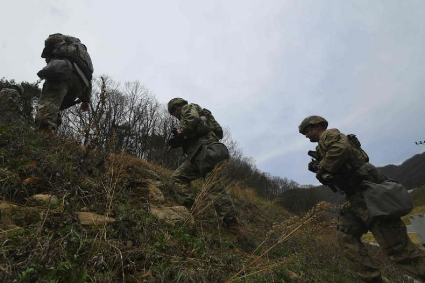 US soldiers participating in a stress shoot test at Camp Casey in Dongducheon, north of Seoul, on April 10, 2018.