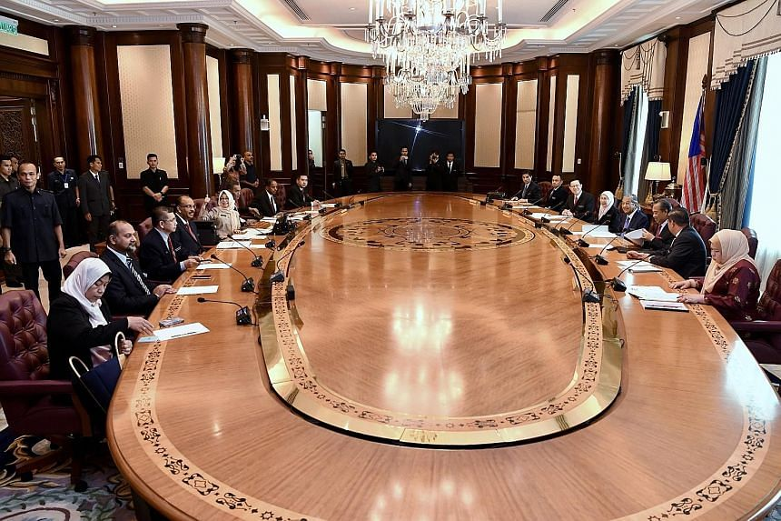 Malaysian Prime Minister Mahathir Mohamad and his Cabinet ministers at their first meeting yesterday in Putrajaya after the May 9 polls.