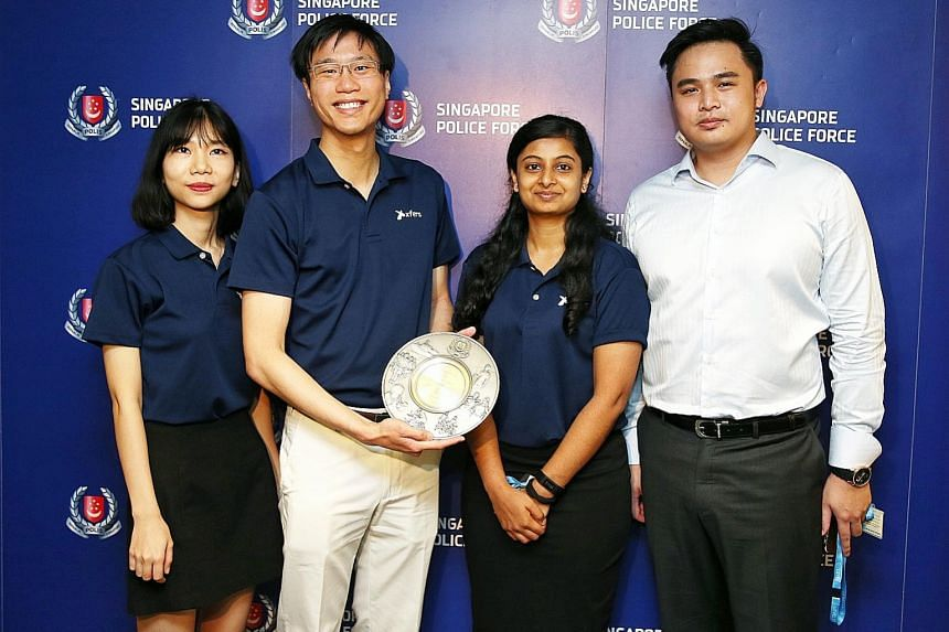 At the appreciation ceremony at the Police Cantonment Complex were Xfers team members (from left) marketing executive Zoe Duong; co-founder and chief legal officer Samson Leo; legal and compliance executive Swathi Bhat; and senior compliance officer