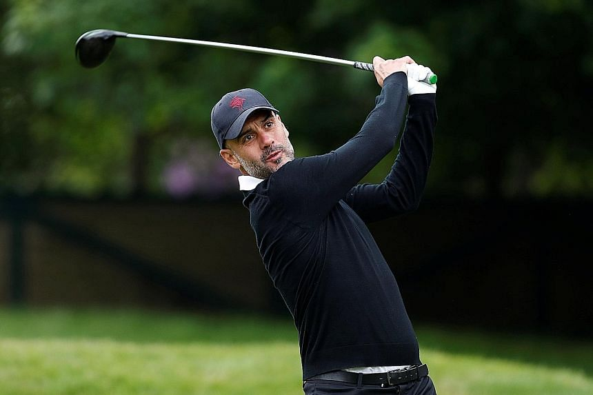 Manchester City manager Pep Guardiola playing in yesterday's BMW PGA Championship pro-am at the Wentworth Club. The US$7 million (S$9.4 million) tournament is the flagship event on the European Tour.