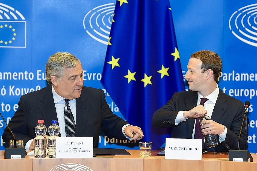 European Parliament president Antonio Tajani (left) and Facebook CEO Mark Zuckerberg in Brussels on Tuesday.