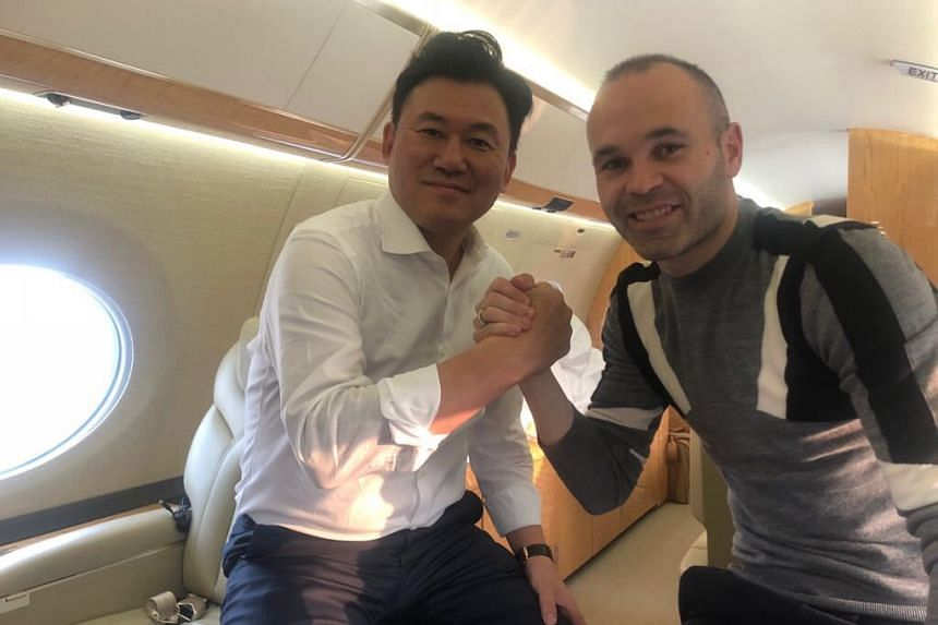 Iniesta, 34, posted a photo of himself and Hiroshi  Mikitani in what appeared to be a private jet.