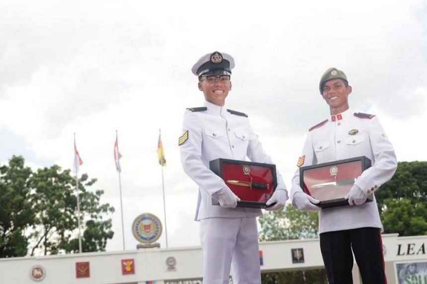 3SG Mohamed Iqbal Abdul Hamid (right) and 3SG Edwin Sim were among 1,038 soldiers from the Singapore Army, Republic of Singapore Navy, and the Republic of Singapore Air Force who graduated as specialists of the Singapore Armed Forces at a parade held
