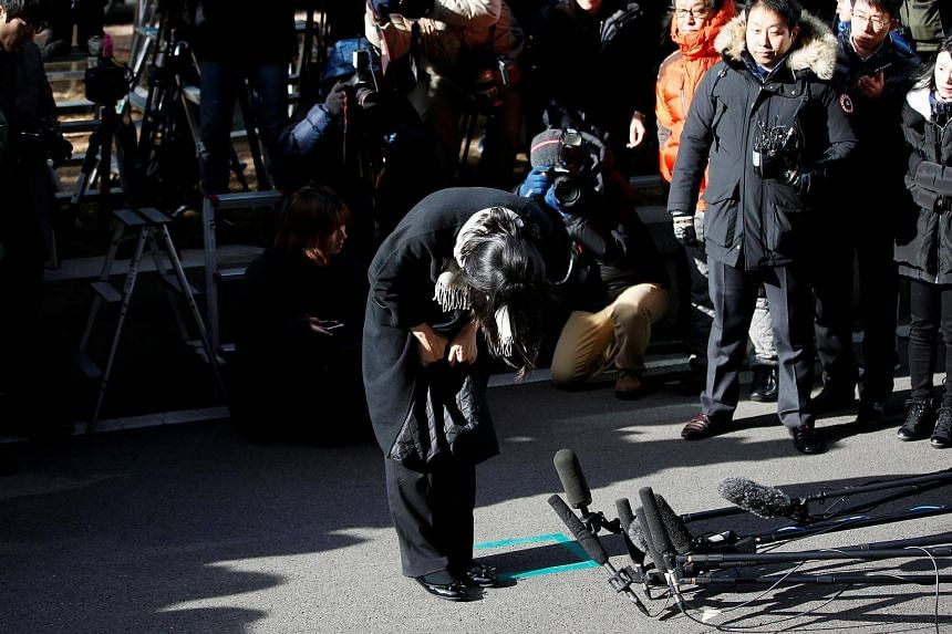 Cho Hyun Ah bowing in front of the media at the Seoul Western District Prosecutor's Office in Seoul on Dec 17, 2014.